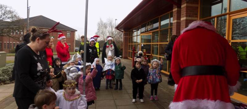 Carol Singing at Arabica and a Visit From Santa!